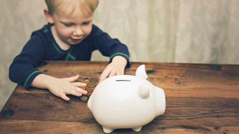 Child using piggy bank