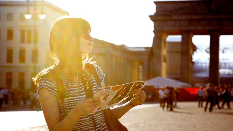 Young tourist examining her map