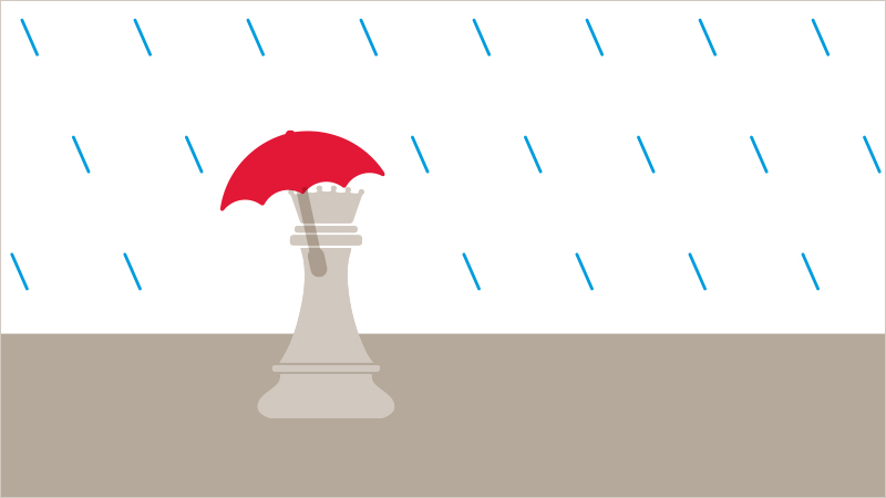 An umbrella protecting a chess queen represents an effective emergency fund