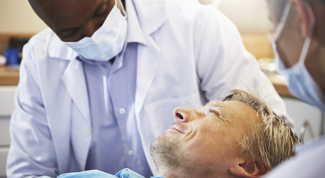 dentist working with patient
